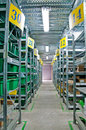 Warehouse with steel shelves and green boxes Royalty Free Stock Photo