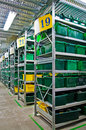 Warehouse with steel shelves and green boxes Royalty Free Stock Photography