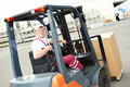 Warehouse worker driver in forklift Royalty Free Stock Image