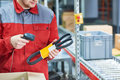 Warehouse worker scanning automobile spare part with laser barcode scanner Royalty Free Stock Photo