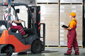 Warehouse works (forklift Royalty Free Stock Photo