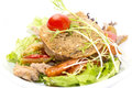Warm beef salad of and vegetables in a restaurant Stock Image