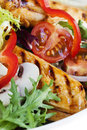 Warm chicken salad grilled with lettuce capsicum mushrooms tomatoes and red onion Royalty Free Stock Image