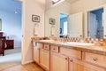 Warm colors bathroom with big mirror Royalty Free Stock Photo