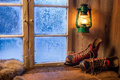 Warm cottage in a winter evening Stock Image
