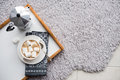 Warm cozy home. Tray and cup of coffee with marshmallows Royalty Free Stock Photo