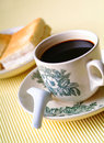 Warm cup of coffee on the brown background Royalty Free Stock Image
