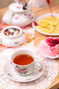 Warm cup of tea and sweets still life with Royalty Free Stock Images