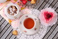Warm cup of tea and sweets still life with Stock Photos