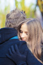 Warm embrace young caucasian female girl hugs her male handsome men standing outside Stock Photo