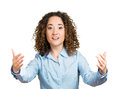 Warm hug closeup portrait young curly brown hair woman motioning with arms to come and give her bear isolated white background Royalty Free Stock Image