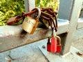 3 padlocks on a bridge