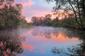 Warm pink sky over the Narew river, Poland. Stock Photography