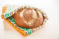 Warm rye bread fresh wrapped in towel Royalty Free Stock Photography
