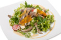 Warm salad with beef tongue with quail eggs and ginger dressing Royalty Free Stock Photography