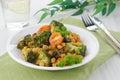 Warm salad with chickpeas, broccoli and raisins Stock Photos