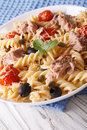 Warm salad fusilli pasta, tuna and tomatoes close up. Vertical Royalty Free Stock Photo