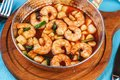 Warm salad of grilled fish pieces, shrimps and mussels in a frying pan, with grilled vegetables Royalty Free Stock Photo