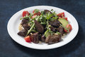 Warm salad from turkey liver