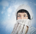 Warm scarf young woman covers her face with a from snow Stock Images