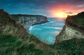 Warm sunset over cliffs and ocean etretat france Royalty Free Stock Images
