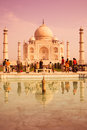 Warm taj a mahal with a crowd in front reflecting in the pool Royalty Free Stock Photography
