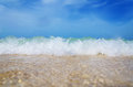Warm tropic sea waves on the beach Royalty Free Stock Photo