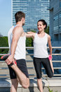 Warm up couple exercising and stretching muscles before sport activity in city Royalty Free Stock Photography