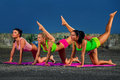 Warm up photo of three girls stretching for before exercise Stock Images
