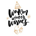 Warm winter wishes text. Greeting card with brush calligraphy and hand drawn illustrations of mittens and hat