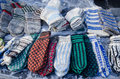 Warm woven knit wool woollen sox socks market fair lot of stockings sell in outdoor street Royalty Free Stock Photography