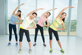 Warming up a group of young women in the aerobics class together Royalty Free Stock Image