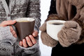 Warming up two people holding mugs with hot drinks Stock Photography