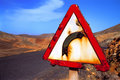 Warn sigh caution sharp curve in the desert Royalty Free Stock Photos