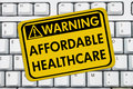 Warning of affordable healthcare website a yellow sign on a keyboard Royalty Free Stock Images