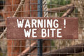 Warning we bite sign that exhibit held within may Stock Photo