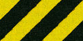 Warning black and yellow hazard stripes texture construction sign Royalty Free Stock Image