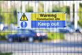 Warning construction area sign on site fence Royalty Free Stock Photo