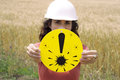 Warning protection equipment needed woman holding the exclamation mark indicating that you need Royalty Free Stock Image