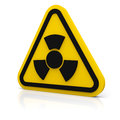 Warning radiation sign yellow triangle with a symbol on white glossy plane Stock Photography