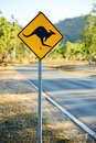 Warning road sign showing a kangaroo shape Royalty Free Stock Photo