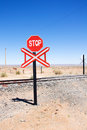 Warning of road sign - stop and railway Stock Image