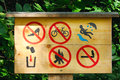 Warning sign board in a forest Royalty Free Stock Photos