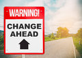 Warning sign on bright street saying Change ahead. Royalty Free Stock Photo