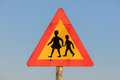 Warning sign of children crossing street from school Royalty Free Stock Photo