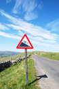Warning sign on deserted road Royalty Free Stock Photo