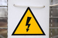 Warning sign electricity black lighting on yellow triangle Royalty Free Stock Photos