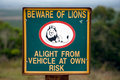 Warning sign on a fence of a south african game park wooden lion Stock Photography