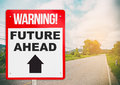 Warning sign with Future Ahead on a road. Royalty Free Stock Photo