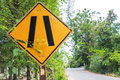 Warning sign label yellow and black going to the narrow way Stock Image